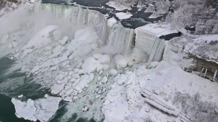 Niagara Falls partially freezes over as US cold snap hits Canada - Pictures