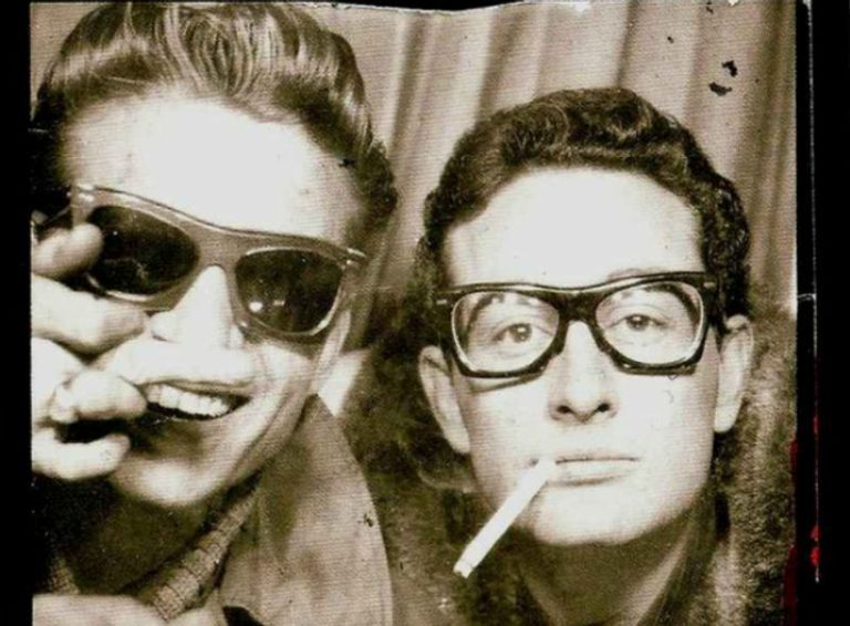 Buddy Holly and Waylon Jennings in a photobooth, 1959