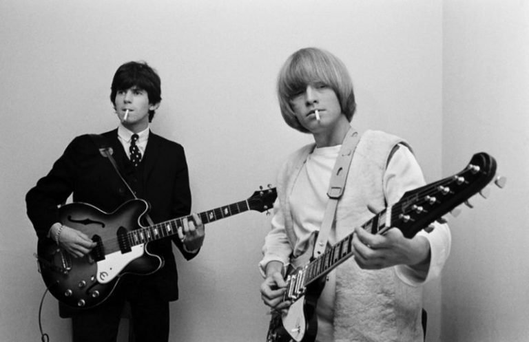 Rolling Stones members Keith Richards, Brian Jones backstage 1965