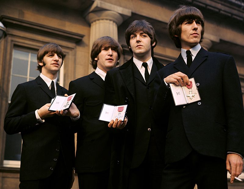 The Beatles showing their MBE Insignias